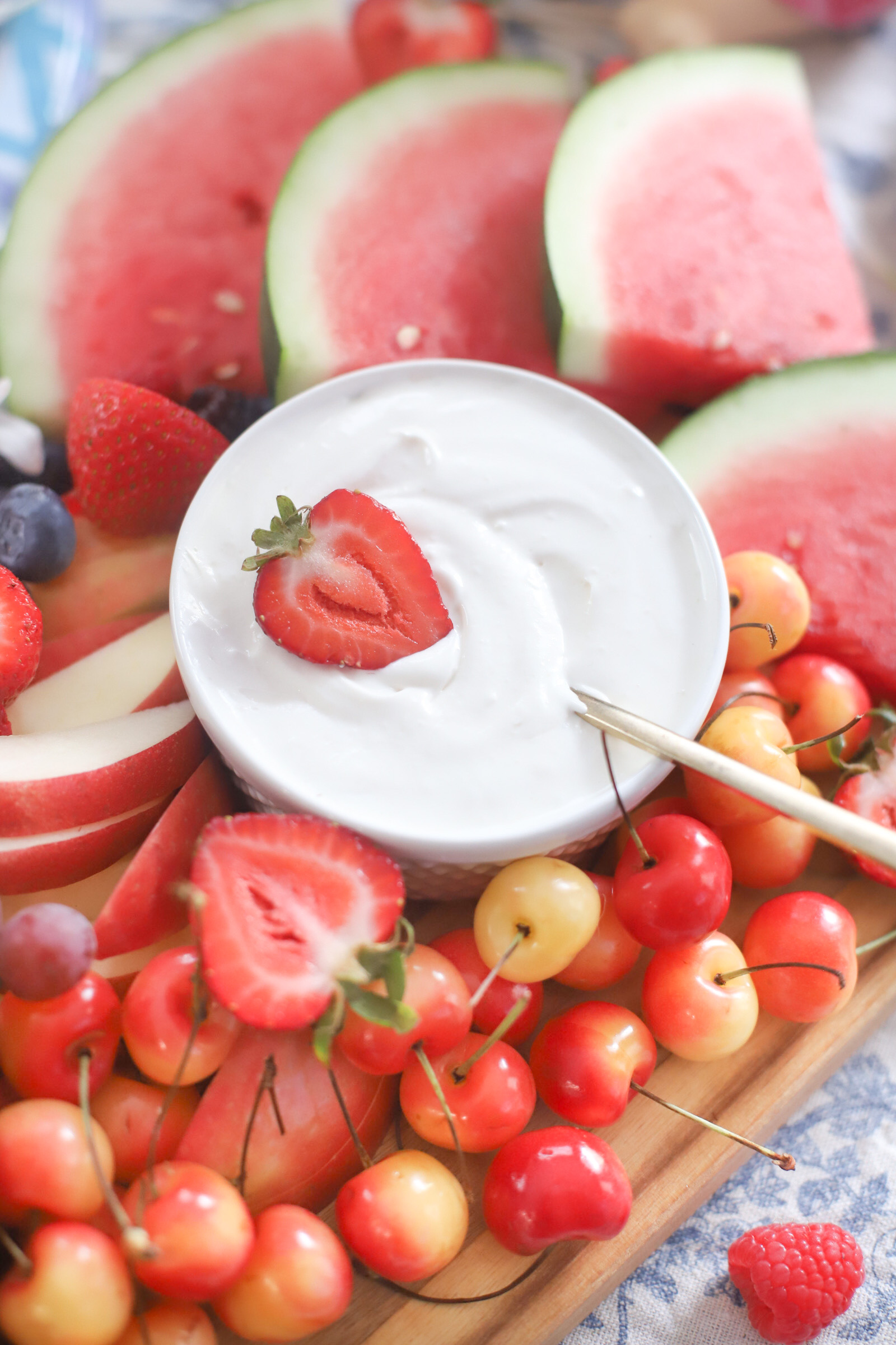 Dairy Free Marshmallow Cheesecake Dip and fruits on a board