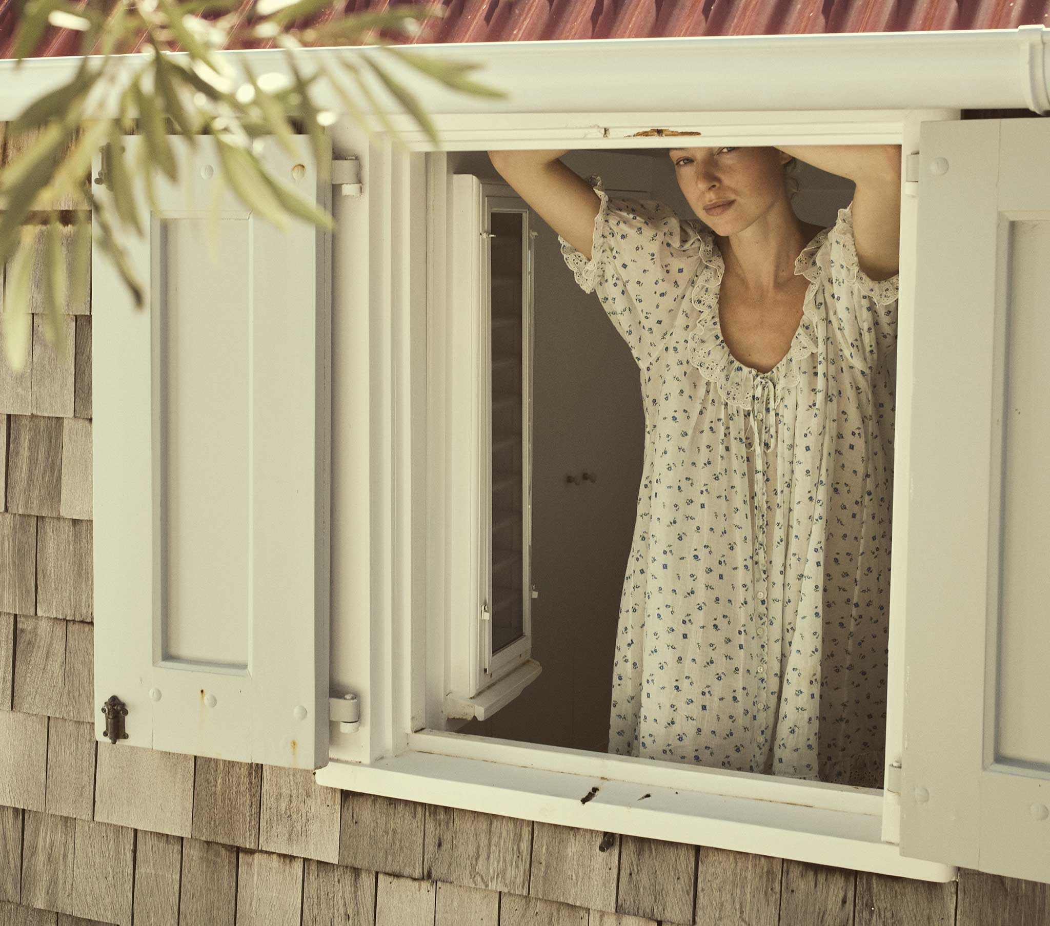 woman looking from the window wearing Trend Spotting Nightgowns