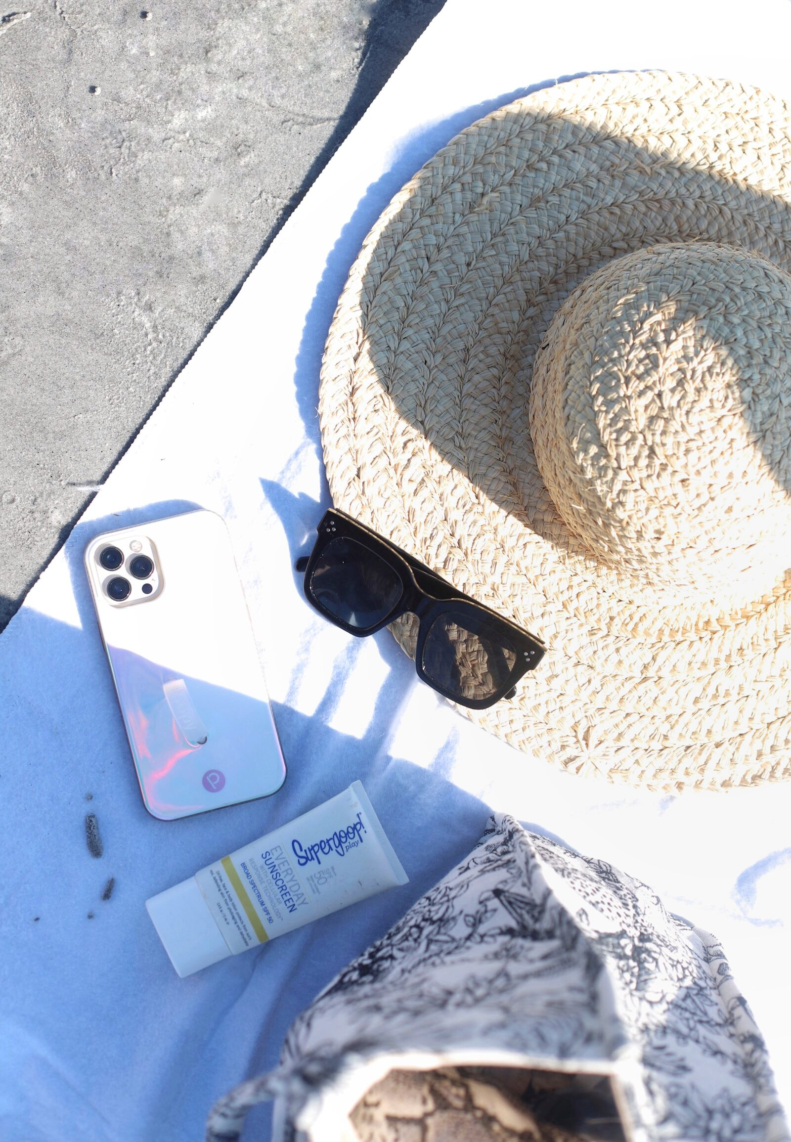 straw hat, favorite sunglasses from Amazon, sunblock, and phone