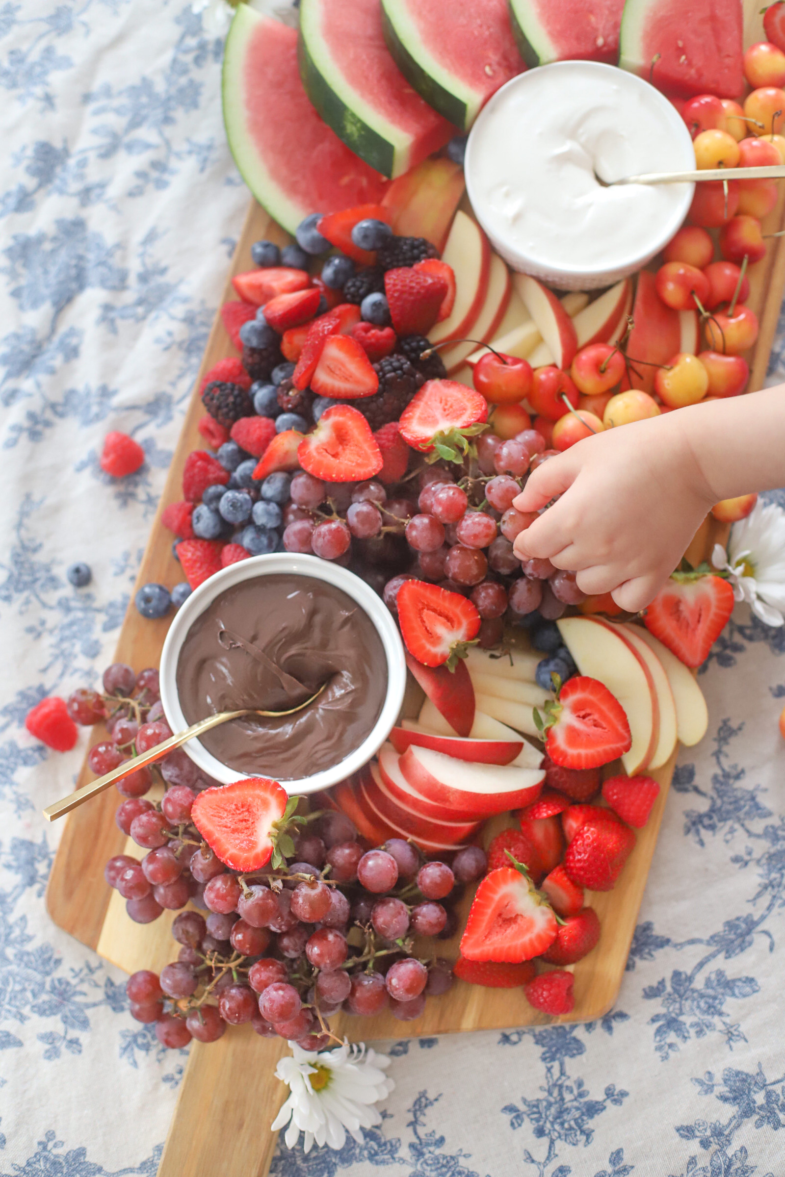 wooden board with fruits and dip