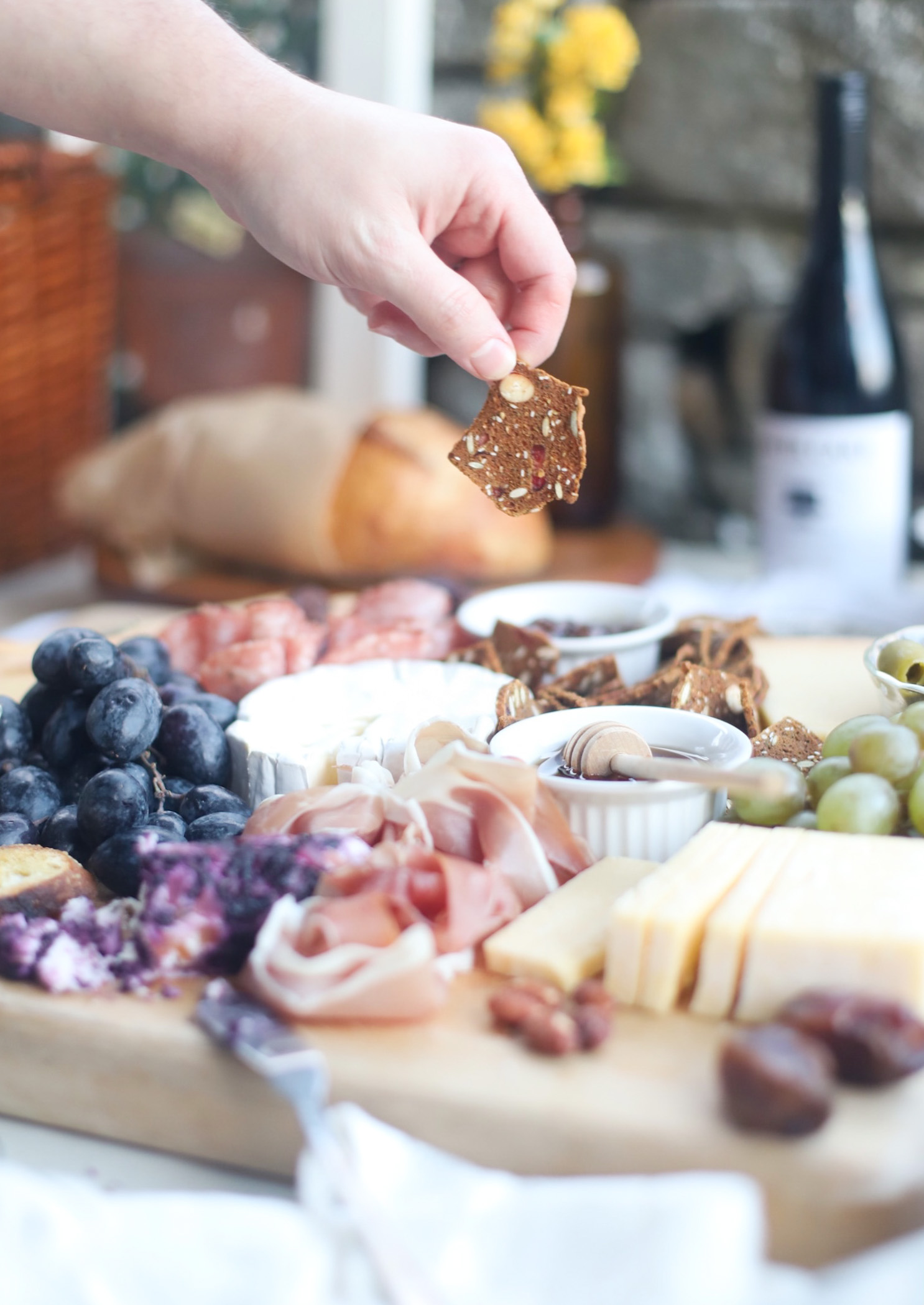 person picking food from a Charcuterie