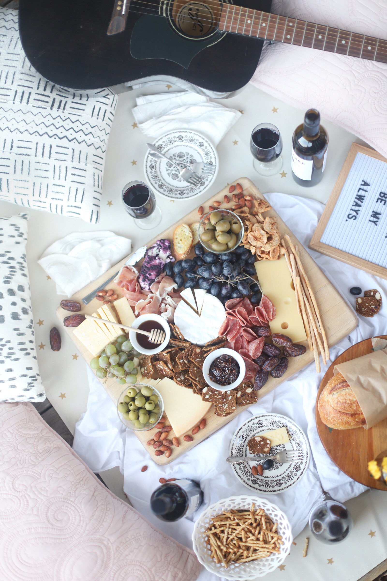top view of Charcuterie and Wine for date night porch picnic with ukulele