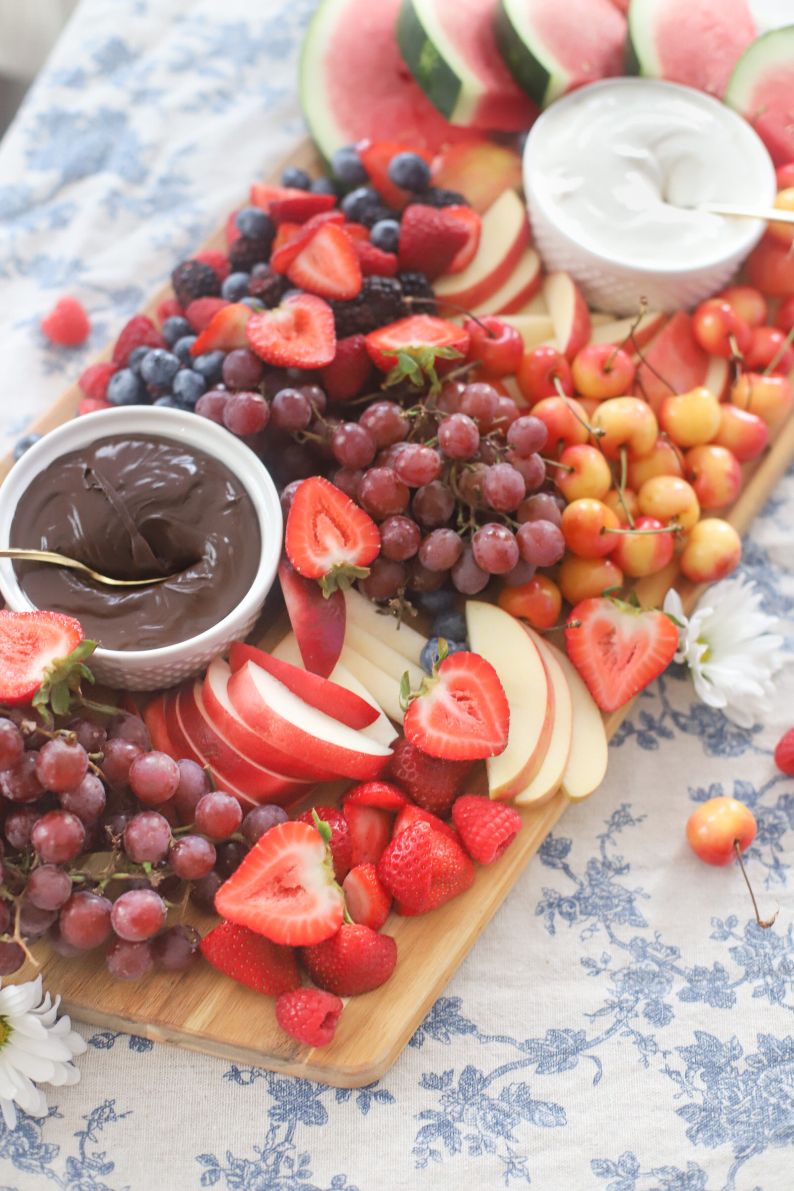 fruits on a board with dips