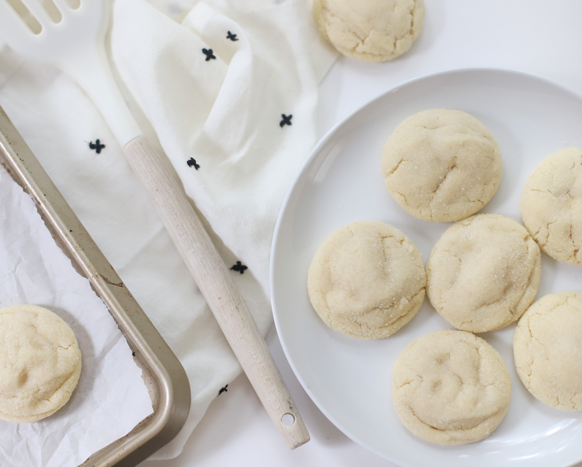 soft Dairy Free Sprinkle Sugar Cookies without sprinkles  on a white plate