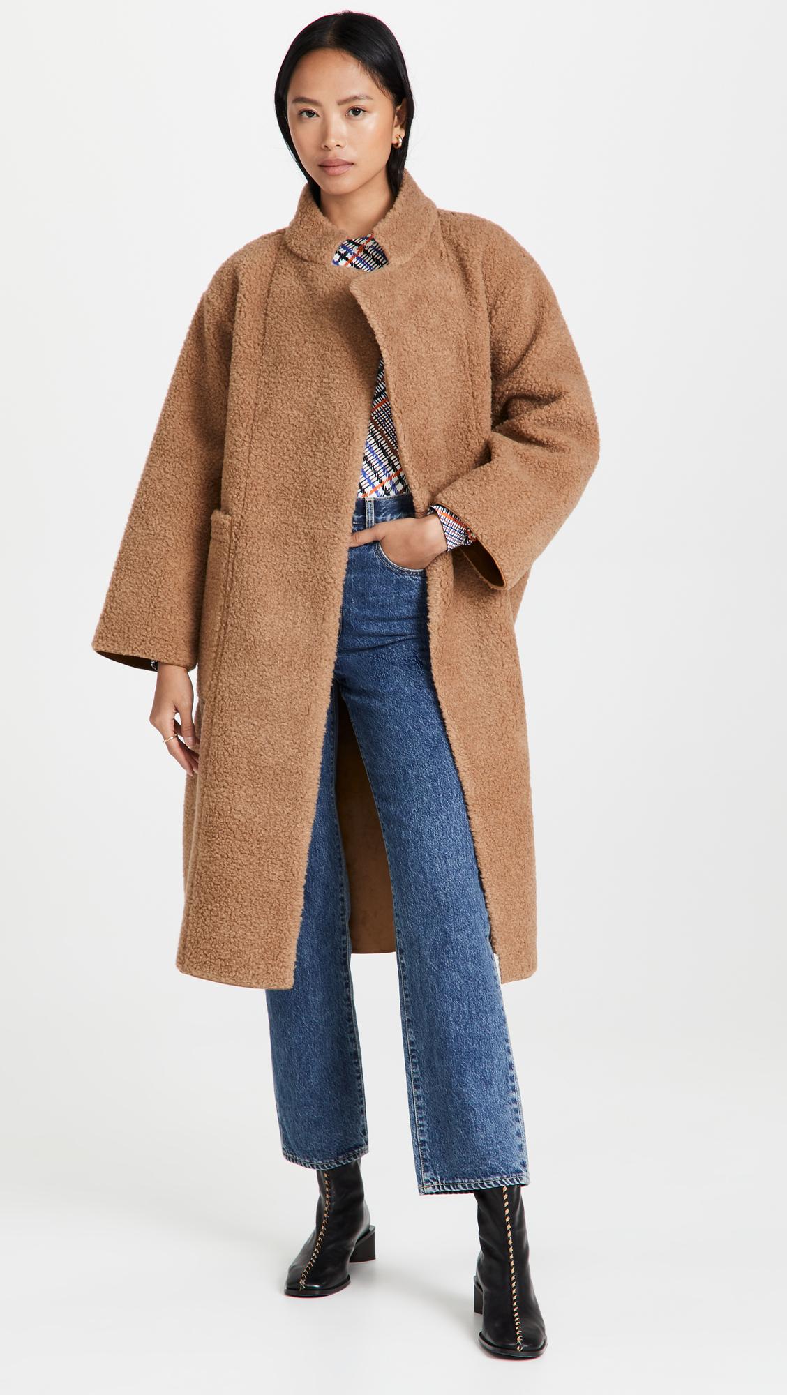 woman wearing Apiece Apart Cloud Walk Coat