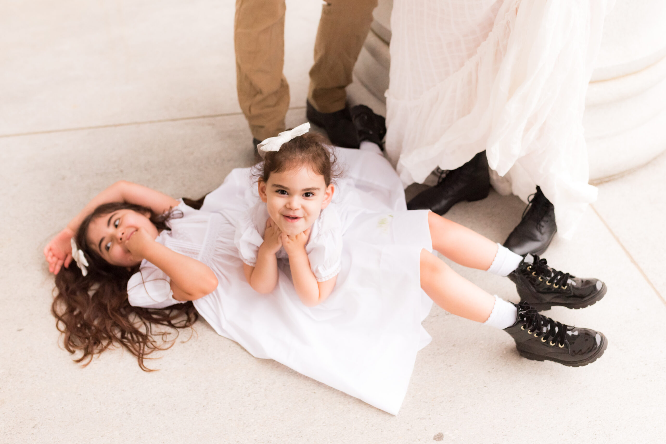 two kids laying on the floor