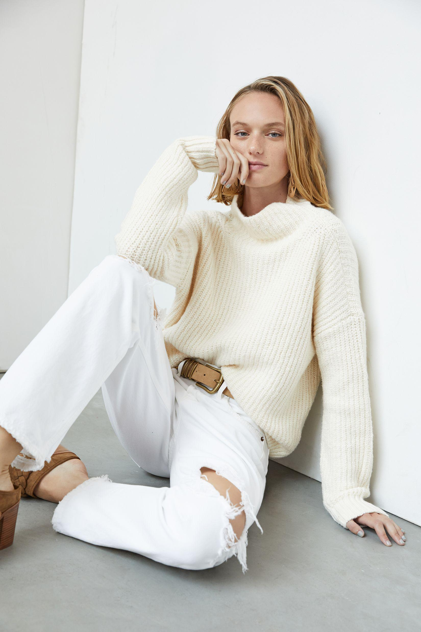 woman in Anthropologie Funnel Neck Favorite Fall Sweaters and white jeans